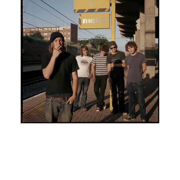 Members of Afrikaans punk band Fokofpolisiekar (Fuck Off Police Car) pose for pictures. Ltr: Francois (vocals), Wynand (bass guitar), Hunter (guitar), Jaco (drums), Johnny (guitar). Rissik Street Station, Pretoria. March 2004 (cp-2004-rm-001-12)